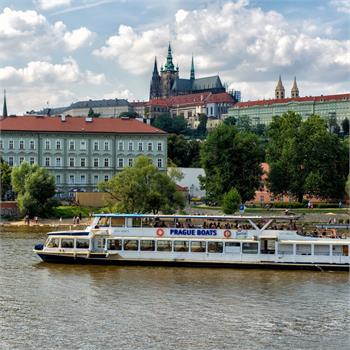 The boat danubio and Prague Castle panorama