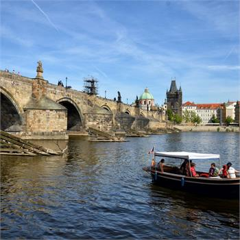 Boat Šárka and Charles bridge