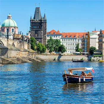 Sightseeing cruise through Prague on small boats