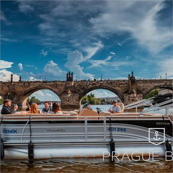 Boat Šemík with panorama of Charles Bridge