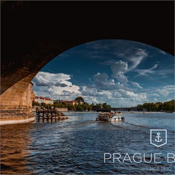 Boat Šemík cruises under Charles Bridge