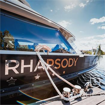 Bohemia Rhapsody Boat is anchored at the dock