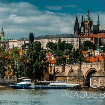 Grand Bohemia boat with panorama of Prague Castle