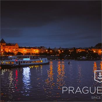 Evening panorama of Prague with Labe boat